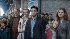 "SUNDAY CALENDAR AUGUST 7, 2011. DO NOT USE PRIOR TO PUBLICATION ******************** (L-r) RYAN TURNER as Hugo Weasley (19 years later), RUPERT GRINT as Ron Weasley, EMMA WATSON as Hermione Granger, DANIEL RADCLIFFE as Harry Potter, DAPHNE DE BEISTEGUI as Lily Potter (19 years later) and BONNIE WRIGHT as Ginny Weasley in Warner Bros. Pictures' fantasy adventure movie ""HARRY POTTER AND THE DEATHLY HALLOWS - PART 2,"" a Warner Bros. Pictures release. Photo courtesy of Warner Bros. Pictures"